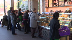 Customers queue at coffee shop Stock Footage
