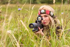 Woman looking into the optical sight - stock photo