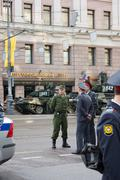 MOSCOW, RUSSIA - MAY 9, 2010: Police and military men near the T-90 tank prep - stock photo