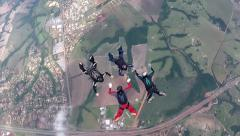 Skydiving 4 way team Stock Footage