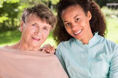 Friendship between retiree and nurse - stock photo
