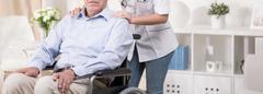 Retiree sitting in a wheelchair Stock Photos