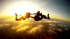 Skydiving tandem sunset group Stock Footage