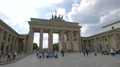 View of a velo taxi near the Brandenburg Gate and people walking, Berlin Stock Footage