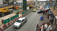 Cars turn out to street, pointsman stopped the main flow, construction site Stock Footage