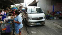 Walk through market area, minibus rush towards, people walk around Stock Footage