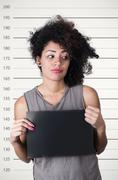 Hispanic brunette model with afro like hair wearing grey sleeveless shirt Stock Photos