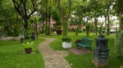 Walk by beautiful Himmapan park, fine gardening and perfect lawn, POV shot. Stock Footage