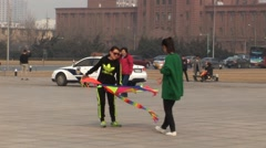 Chinese women with kite ready to fly - stock footage