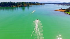 Jetski riders racing on a blue lake - stock footage