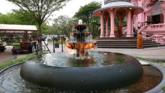 Small fountain cascade over stony pool, in front of Erwan Museum Stock Footage