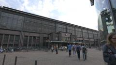 People walking in front of Friedrichstrasse station entrance, Berlin Stock Footage
