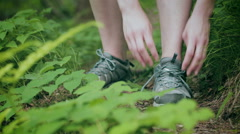 Hiker Tying Her Shoes on a Trail Stock Footage