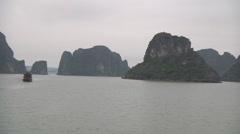 Ships sailing between mountain islands, Hạ Long Bay, North Vietnam Stock Footage