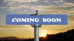 Coming soon road sign with flowing clouds Stock Footage
