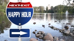 Happy hour road sign Stock Footage