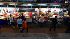 Fry and grill fish, chicken legs, street fast food stands at sideway, night time Stock Footage