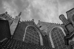 Gothic windows and architectural details on a church in Amsterdam Stock Photos