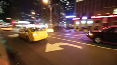 New York City taxi cab speeding through night streets of Manhattan Tracking shot Stock Footage