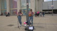 Man and woman performing in Alexanderplatz, Berlin Stock Footage