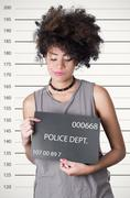 Hispanic brunette rebel model afro like hair wearing grey sleeveless shirt Stock Photos