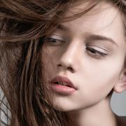 Fashion model with full lips. Close-up portrait Stock Photos