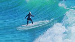 Female surfer surfing swell waves in Santa Monica, California. Slow motion. Stock Footage