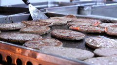 Fast Food Worker Flipping Hamburgers On Grill Stock Footage