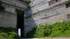 Tunnel in the mountain in an abandoned limestone quarry. Stock Footage
