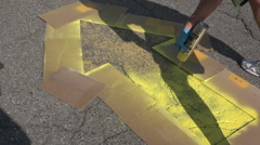 Stock Video Footage of Painting Yellow Directional Arrow in Parking Lot