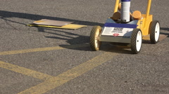 Re-painting Yellow Lines in a Parking Lot Stock Footage
