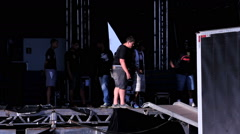 Stage With Instruments And People Setting Up Before A Concert Stock Footage