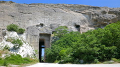 A car drives out of the tunnel into the mountain in an abandoned quarry. Stock Footage