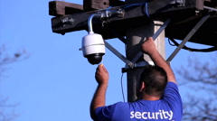 Man instaling a security cam. Worker. Stock Footage