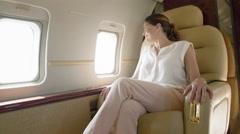 Woman passenger waves through plane window 4K - stock footage
