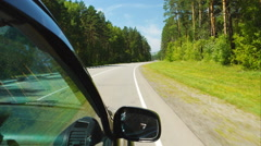 Car is moving across the Wood in Altay (POV) Stock Footage