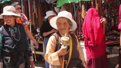 Tibetan women with Buddhist prayer wheels Stock Footage