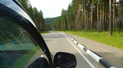 Car is moving on road in the forest in Altay (POV) Stock Footage