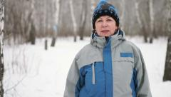 Portrait of an adult woman in the forest in winter Stock Footage