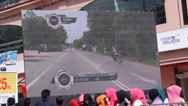 Stock Video Footage of cyclist on giant screen