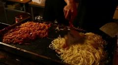 Food stand at Bon-odori traditional summer dance festival at Tsukiji Honganji Stock Footage
