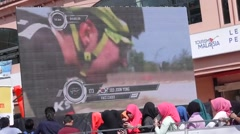 Cyclist on giant screen Stock Footage