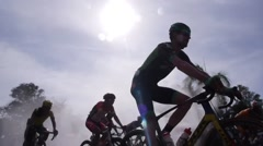 Cycling in water spray Stock Footage