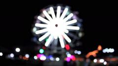 Ferris wheel lights sparkle brightly. Blur Stock Footage