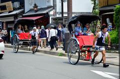 Stock Photo of Traveler use rickshaw for tour around arashiyama city