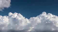 Beautiful white cumulus clouds rolling over blue sky background. Timelapse view - stock footage