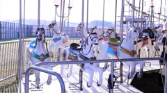 Carousel in amusement park Stock Footage