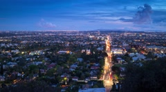 Zoom in city of Los Angeles skyline changing twilight to night. 4K UHD Timelapse Stock Footage