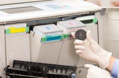 Closeup shot technician fixing broken photocopier machine Stock Photos