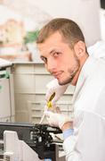 Closeup shot technician fixing photocopier machine Stock Photos
